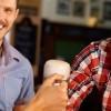 Customers enjoying a beer in a well-insured pub, public house, bar or inn